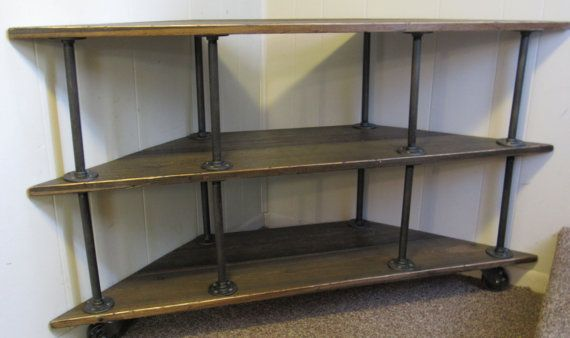 Industrial-style Corner TV Stand is made from rough-cut cedar, iron pipe, and iron fittings