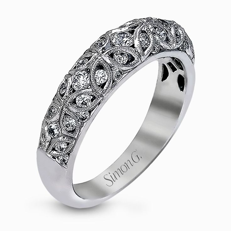 This lacy vintage inspired white gold band features .62 ctw of round cut white diamonds in a charming floral design. Print Page