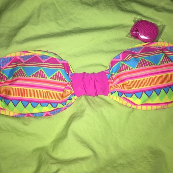 SATURDAY SALE Neon Aztec Bandeau Bikini Top This Neon Aztec Bandeau Swim Top is perfect for the summer! It has adjustable/removable straps & hooks in the back. Never been worn! New without tags! Xhilaration Swim Bikinis