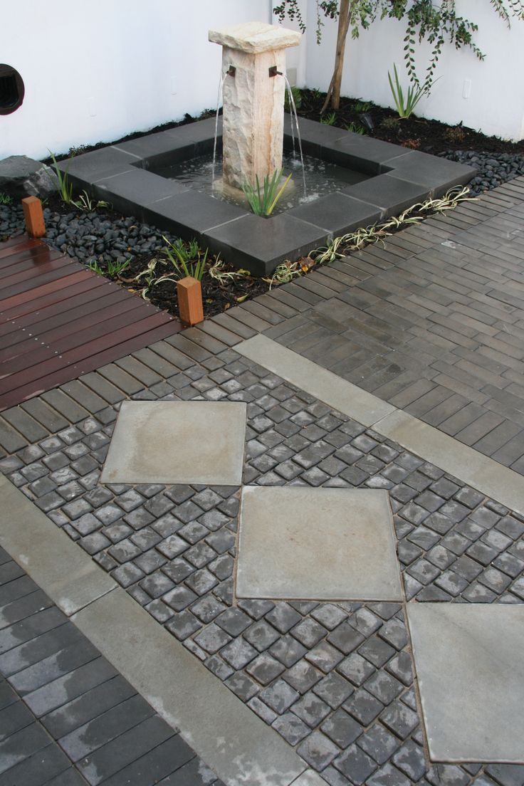Need some inspiration for your landscaping needs? View our large selection of landscape products on our website. Seen here are Jura pavers & Jura edging & York cobbles.