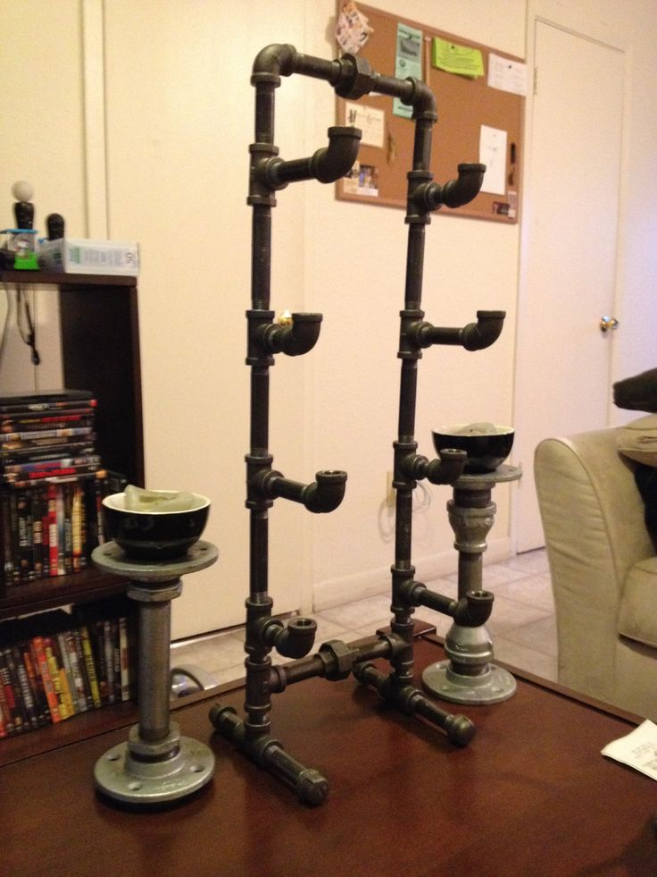 Wine Rack And Candle Sticks Made From Black Iron And