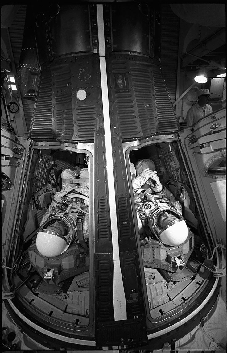 Astronauts James McDivitt and Ed White inside the Gemini spacecraft for a simulated launch at Cape Canaveral, Florida
