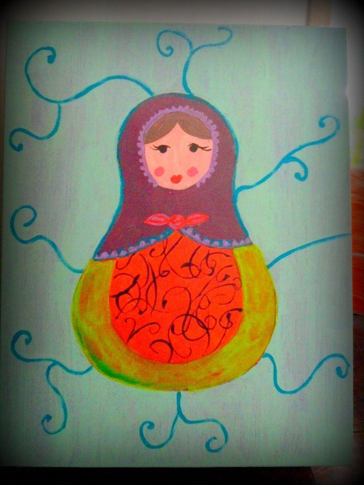 Caja de juguetes pintada con una Mamushka.