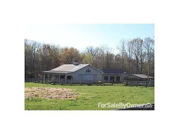 Separately available - gorgeous 5 stall barn, 3 car garage/storage building, isolation pen, and large storage building (for tractor, equipment)