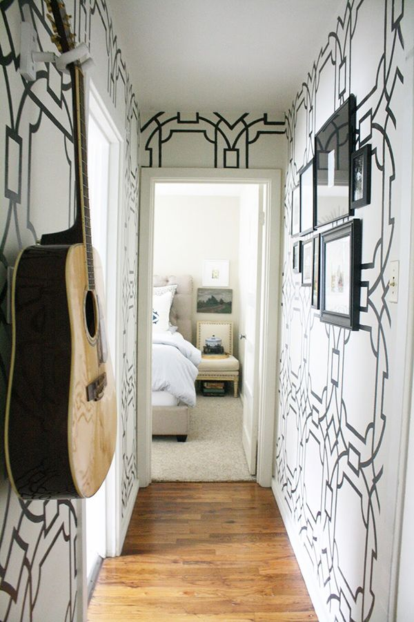 wallpaper look for less. This is an easy solution to wanting the wallpaper look by just using a cheap stencil. Love this geometric look in our hallway. The black and white really pops.