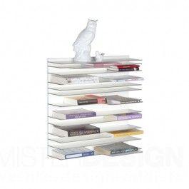 De Spectrum Paperback Boekenkast Paperback is een wandkast, ontworpen door Studio Parade in 2009. De kracht van het ontwerp is dat het minimale ruimte inneemt in een interieur en tegelijkertijd een opvallende verschijningsvorm heeft. De dunne legplanken leveren een bijzonder lijnenspel. De paperback krijgt door de invulling van boeken, cd's en kleine glas of keramiek voorwerpen een eigen grafiek en palet aan kleuren.  Paperback is modulair en bestaat per set uit één stevige wandplaat van 60…