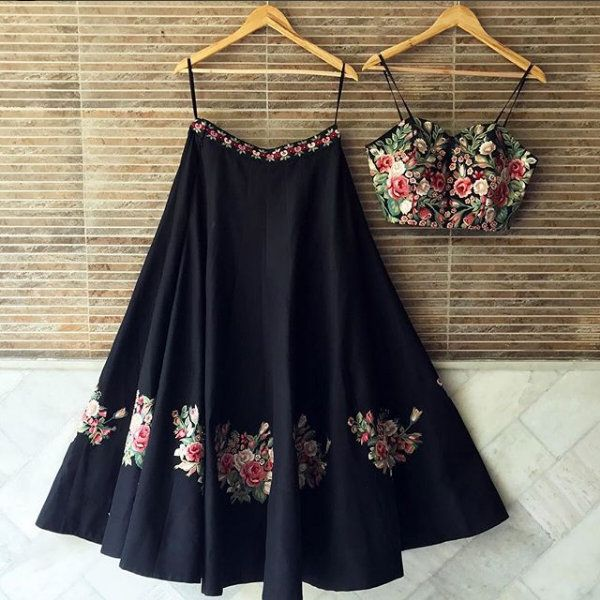 FOR THE BOHEMIAN BRIDE ♥️ . This set features a black strappy blouse in chanderi base with multicolor floral thread embroidery on the front anad back. It is paired with matching black flared kalidaar chanderi lehenga skirt with multicolor floral motifs around the hem and embroidered waistband. It comes along with pink net dupatta with embroidered border. Shop now! #ruhmahsa #indianfashion #indiandesigner #shopnow #perniaspopupshop #happyshopping #newyearsfashiongoals #fashion2018