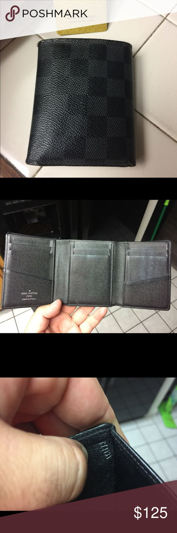 100% authentic LV Graphite Damier Trifold wallet Purchased at the LV store in Costa Mesa (South coast plaza) in So. Calif. It is used but has lots of life left. Purchased at retail between $520-$540. Louis Vuitton Accessories Key & Card Holders