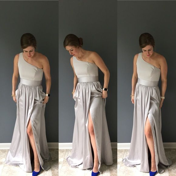 Vera Wang bridesmaid dress This dress is timeless and chic and the light silver-y color looks great on most skin tones. It is a one shoulder Vera Wang White collection bridesmaid dress with satin sash. Color is Sterling. Brand new with tags. Vera Wang Dresses Wedding