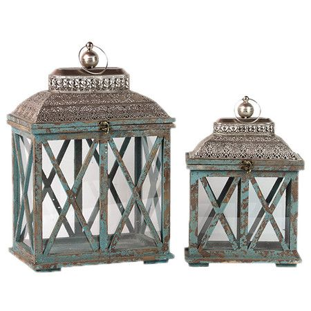 Set of 2 weathered candle lanterns with latticework doors.  Product: Small and large lanternConstruction Material:  M...