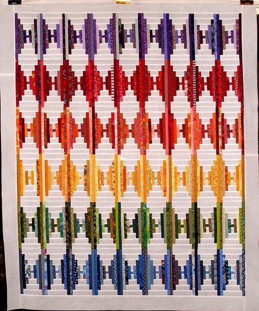 T-Rainbow Rhombus by Linda Rotz Miller Quilts Quilt Tops, via Flickr...Log Cabin technique?