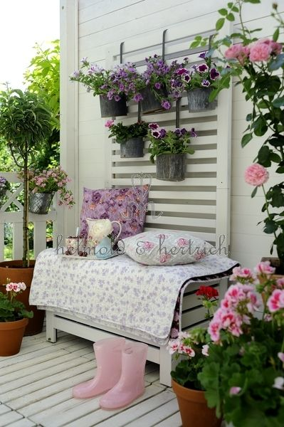 hanging containers and pretty pink boots!