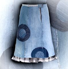 Aureola skirt -  The skirt made of upcycled jeans, with raw, unprocessed edges. Tulle at the bottom. Measuring about 62 cm.  61.00 €  http://www.kesidov.eu/skirts-shirts/
