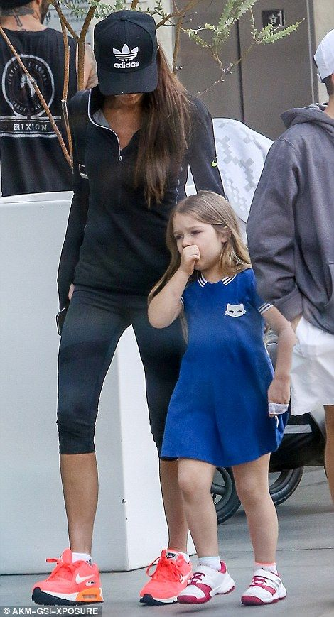 Enjoying the sunshine: Harper sucked her thumb and fiddled with her dress label as she fol...