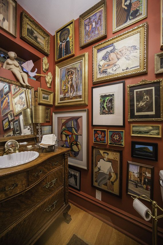 The downstairs powder room in Robert Alter and Sherry Siegel's home in Chicago features over five dozen works of art.