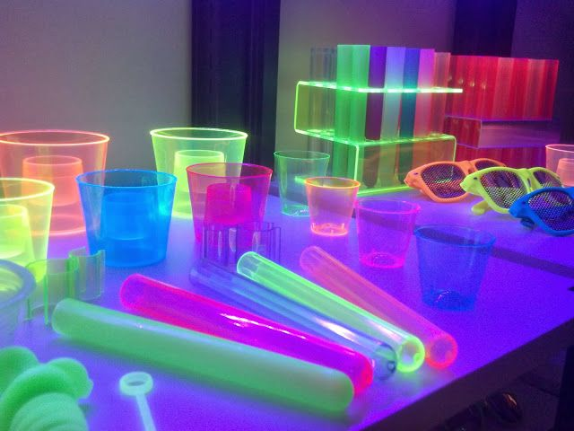 Black light + UV reactive neon GLOW bar supplies would be like so totally cool at an '80s theme party. Fer sure. The colors are very Lisa Frank.