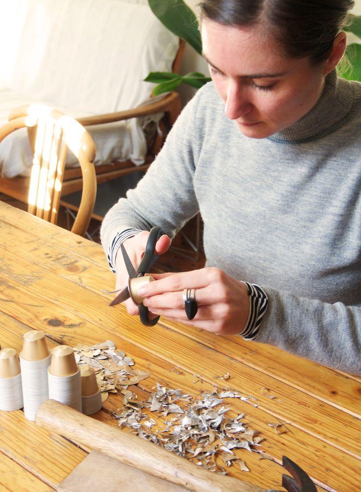 Cutting Nespresso capsules.
