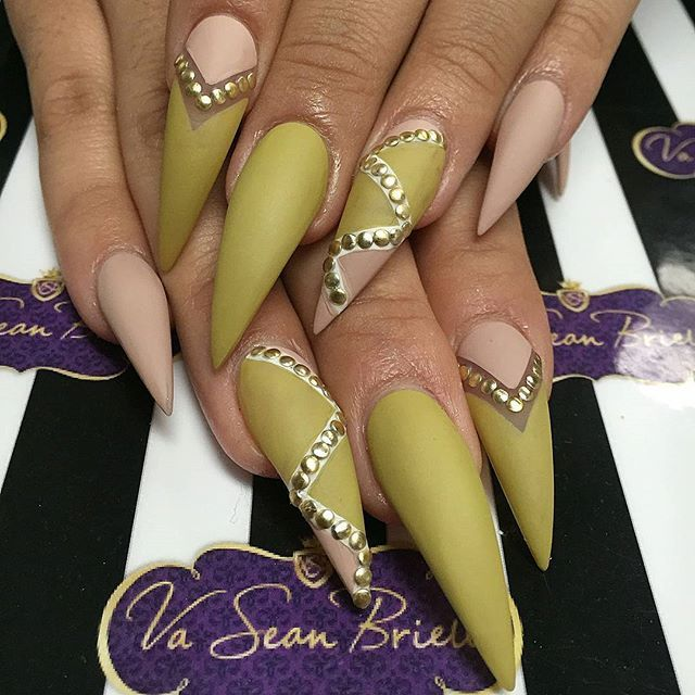 Matte stiletto nail art with studs.  Would love this with nude and black matte design!