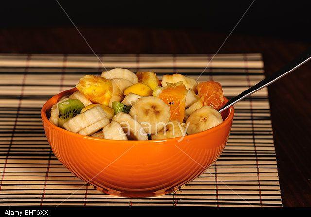 Mixed fruit salad, orange bowl, fresh healthy diet Stock Photo