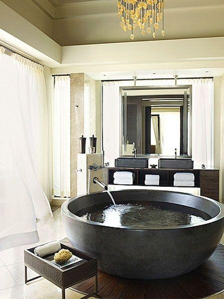 Elegant black and white round bathtub.