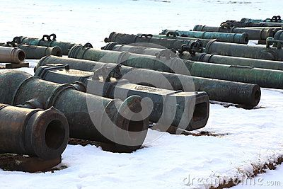 The barrels of the old bronze cannons, stacked near the wall of the Museum building. The territory of the Military-historical Museum of Artillery, engineer and signal corps. St. Petersburg, Russia