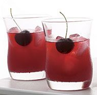 Muddled sweet cherries add a burst of bright color to the classic Mexican cocktail. Look for agave nectar at the supermarket near the honey and maple syrup.