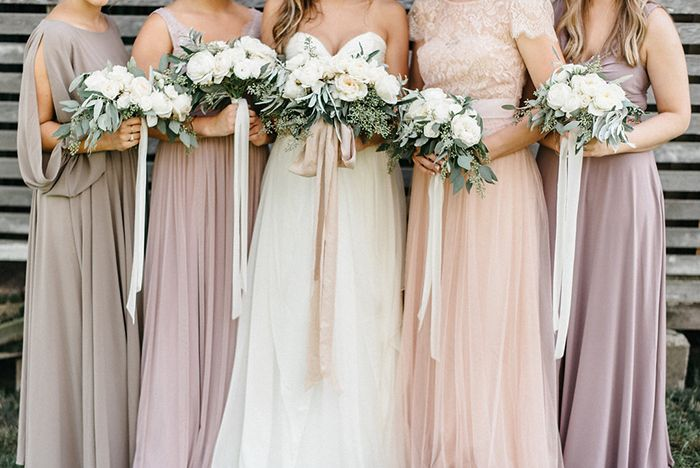 Blush, lavender, and dove gray bridesmaid dresses.