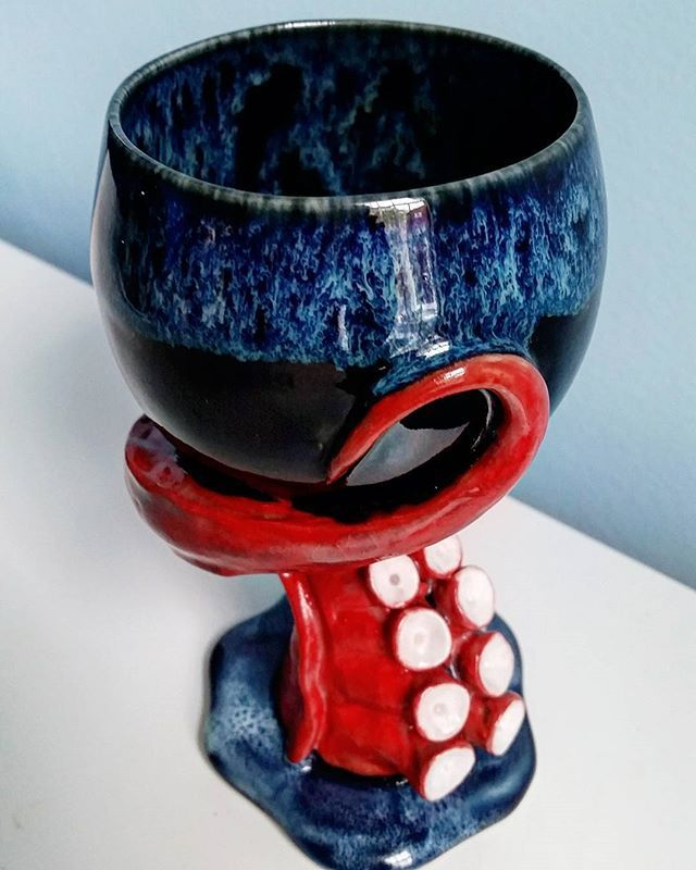 Another shot of the octopus goblet, this one emphasizing the cool glaze pattern on the rim of the cup.  #wineglass #wine #goblet #ceramics #octopus #tentacle #clay #sculpture #art #octonation #pottery #tentacleart #ocean #nautical #suckers