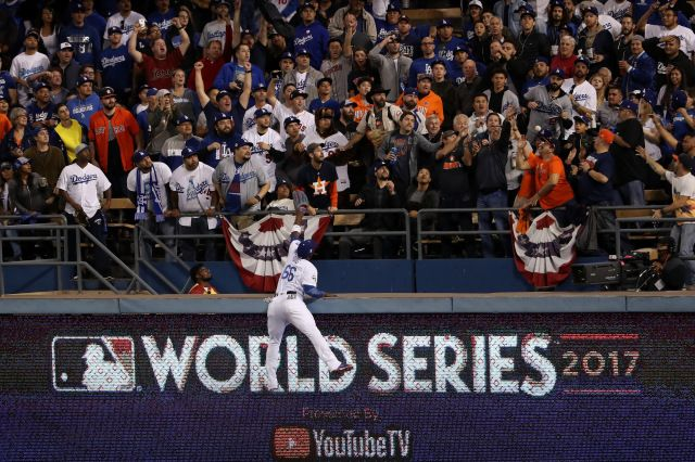 Yasiel Puig #66 of the Los Angeles Dodgers is unable to catch a solo home run ball hit by George Springer #4 of the Houston Astros (not pictured) during the third inning in game six of the 2017 World Series at Dodger Stadium on October 31, 2017 in Los Angeles, California. (Photo by Christian Petersen/Getty Images)