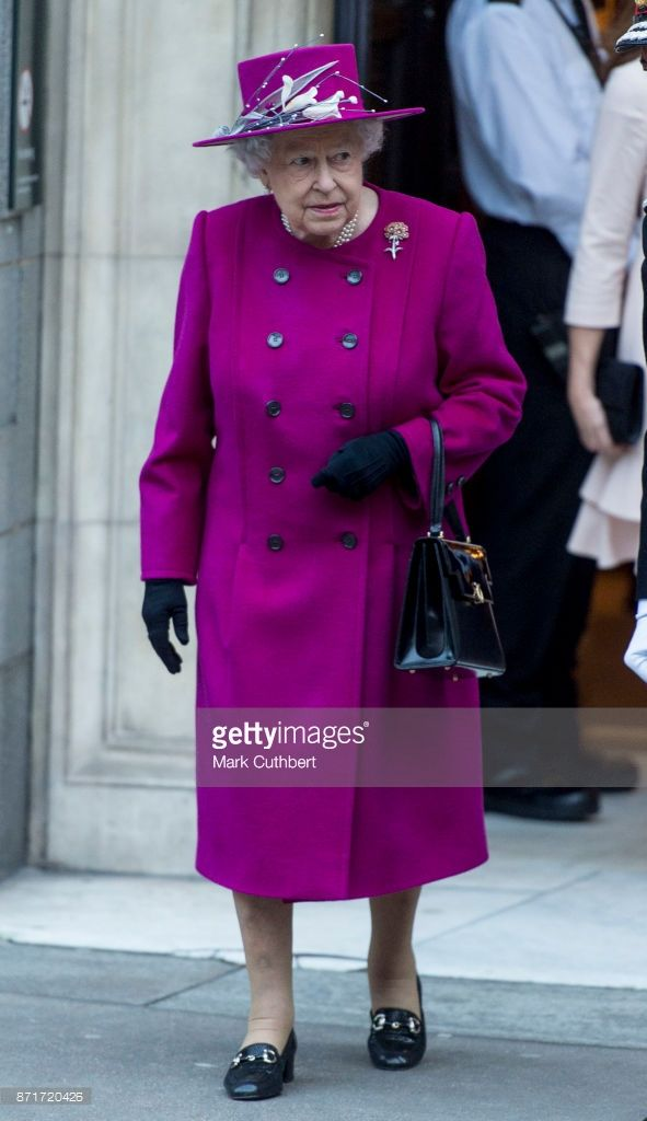 Queen Elizabeth II leaves after reopening The Sir Joseph Hotung Gallery at The British Museum on November 8, 2017 in London, England. Angela Kelly Designs.