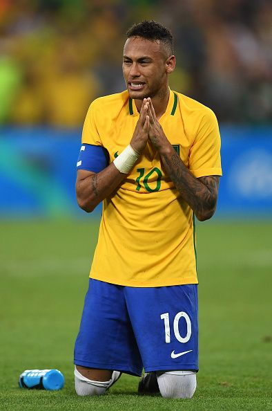 Neymar of Brazil celebrates after scoring the winning penalty in the shoot out…