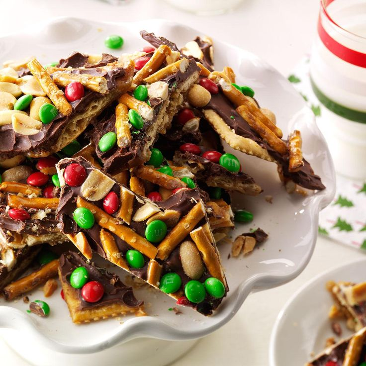 """Chocolate, Peanut & Pretzel Toffee Crisps Recipe -My """"crispers"""" are the ultimate combination of salty and sweet. They never last long because—trust me—they're addictive! Make the recipe the way it's written or sprinkle on any treats you like. —Jennifer Butka, Livonia, Michigan"""