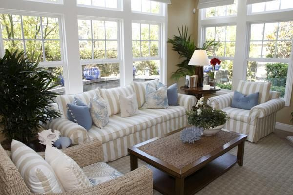 love the sunroom, windows, view & furniture arrangement - the touches of blue are calming
