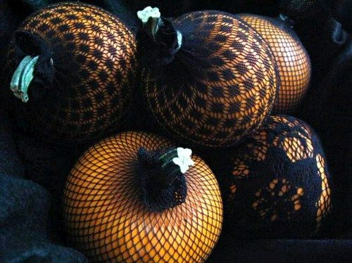 vintagerosegarden:    Glam up your pumpkins by encasing them in fishnet and lace stockings. Love this idea.