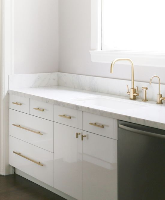 The Zhush: Modern Kitchen Bliss carrara marble white cabinets brass handles and fixtures