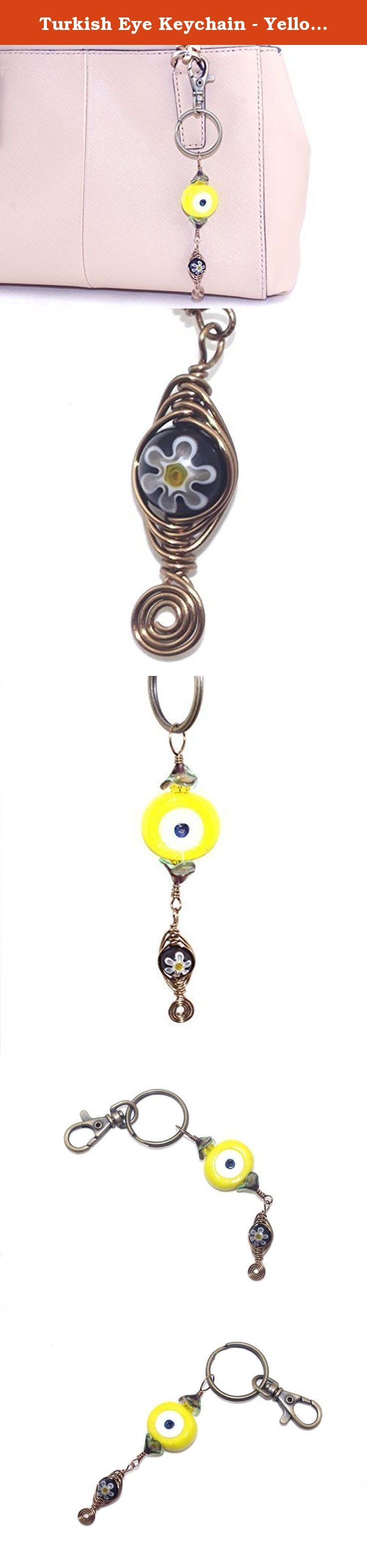 Turkish Eye Keychain - Yellow Brass Millefiori Bead Purse Charm - Zipper Pull Charm - Birthday Present for Her. Brighten up your keys by attaching them to this Turkish eye keychain. The evil eye is embellished with yellow crystals capped with Czech glass bell flowers. A wire wrapped black milleriori bead dangle adds a fun touch. This key chain can also be used as a purse or zipper pull charm. The length of this Turkish eye keychain charm is approximately 3.5 inches (8.89 cm). Materials: -...