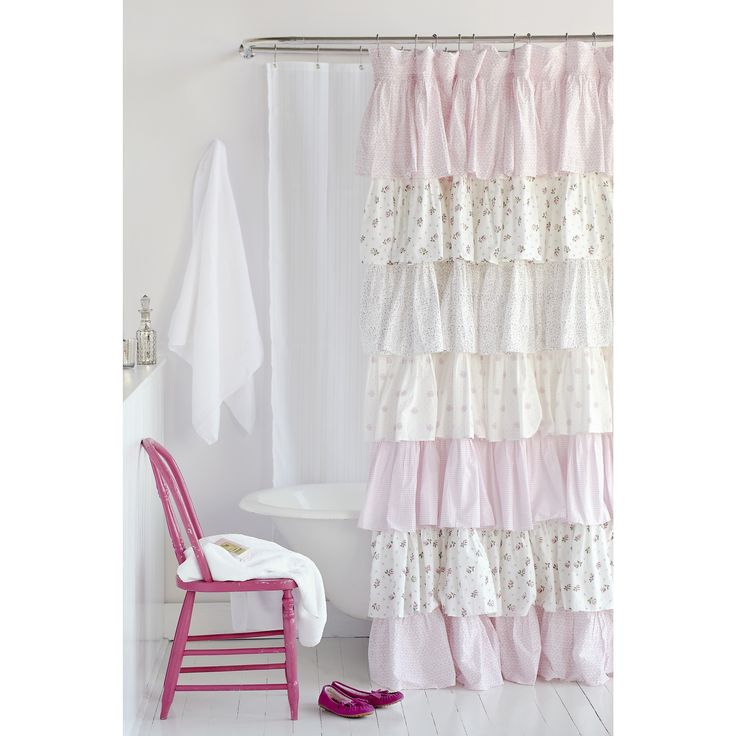 Large French ruffles are decorated with floral, dot and solid patterns to form this charming cottage-style shower curtain. Crafted with pure cotton, this pink and white curtain features a convenient machine washable construction.