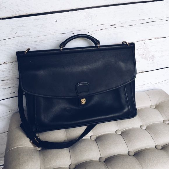 Coach • Black Leather Briefcase Authentic Coach Briefcase. This is a vintage item and will have flaws! There is some buckling in the back and an imprint of a circle on front. Still a beautiful piece. Front pocket has places for pens and business cards, etc. Bags Shoulder Bags