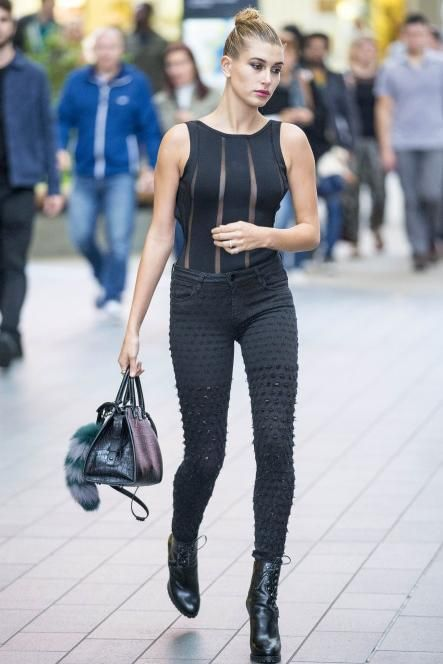 Hailey Baldwin wearing Saint Laurent Cabas Rive Gauche Croc Embossed Bag, Alaia Lace-Up Leather Platform Ankle Boots, Brockenbow Alveoles Honeycomb Skinny Jeans and House of CB Sirine Black Bandage and Mesh One Piece Swimsuit