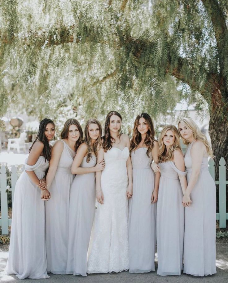 Dove gray maids to go with those loose waves. Get this effortlessly chic look on brideside.com    Photo by: Jenny Smith and Co.