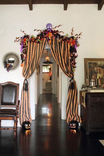 "Re-interpret these Halloween curtains to create an entrance to the ""Bat Cave"" ?"