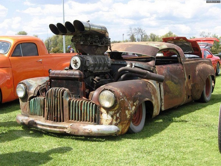rat rod, the pickup bed is Studebaker, the front clip looks like it could be Pontiac, the top is probably late 40s GM coupe, who knows what the rest is.