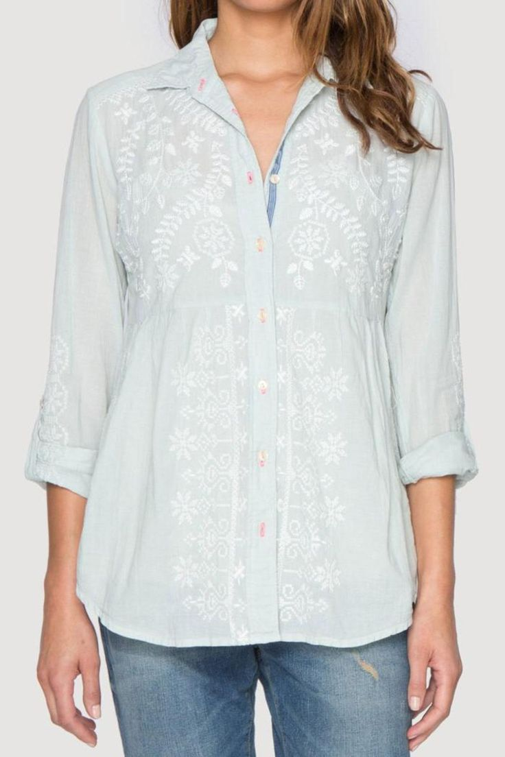 This beautiful shirt by 3J Workshop (a division of Johnny Was) is called the Kim Smock Shirt. It is a fresh new take on the much-loved peplum button down blouse, and this one offers chic white embroidery on front, back, and sleeves. Special touches include a lovely mint colored cotton voile, traditional collar, full button front closure, and long tabbed sleeves. Try pairing this blouse with white linen pants and flat sandals for an easy going and free spirited look. Machine washable in the…