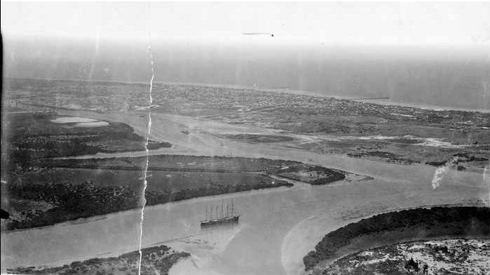 Aerial view of Port Adelaide, South Australia, 1927 - The Port River viewed from above with the suburbs of Henley Beach (on the left) and Largs (on the right) in the distance, and the sea beyond.