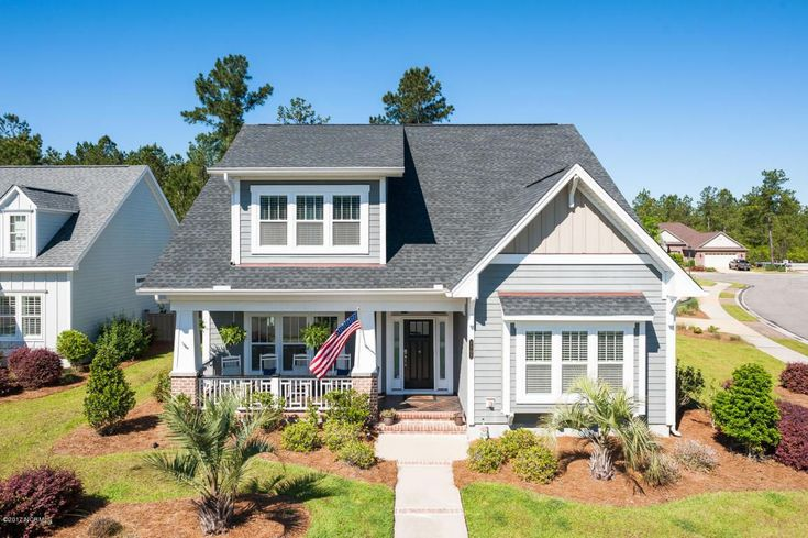 Southern style & coastal craftsmanship come together in this 5BR/3BA home featuring a versatile floor plan & high end finishes! The spacious living room boasts built-ins, gas fireplace & opens to the dining room & impressive kitchen