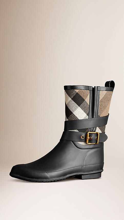 Burberry Black Check Detail Belted Rain Boots -  Matte rubber rain boots with Canvas check panel.  Wrapped strap with vintage-finish metal buckle detail.  Practical rubber grip sole.  Discover the shoes collection at Burberry.com