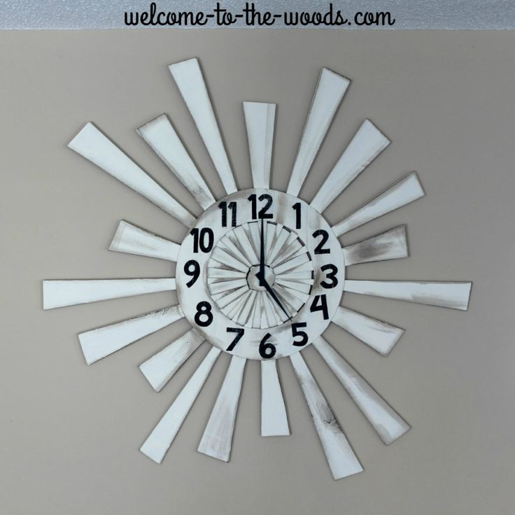 An amazing pallet wood wall clock that is huge and makes a statement!