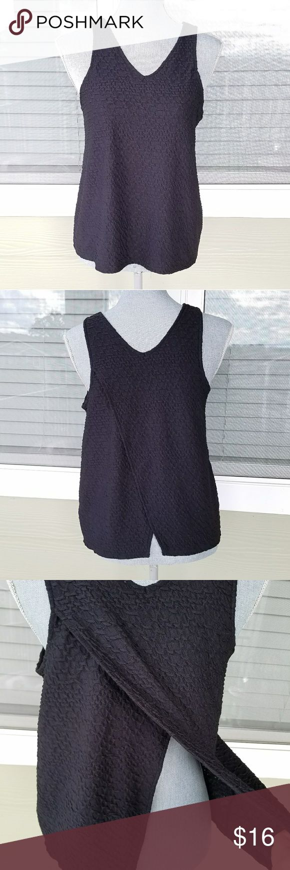 Anthropologie Deletta Tank Black textured tank top with open back. Flaps on the back stay closed while wearing (unless you bend over, etc.) In great condition! Size medium. Anthropologie Tops Tank Tops