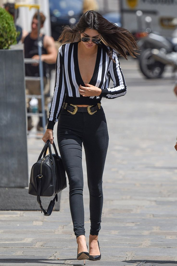 Kendall Jenner wearing deep V neck black and white striped shirt, black skinny jeans and black pointed toe heels. Beauty on High Heels #Fashion