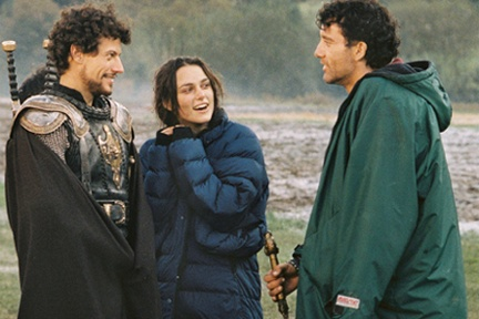 King Arthur (movie) Stars Ioan Gruffudd (left), Keira Knightley (center) and Clive Owen (right) share a light moment between takes.